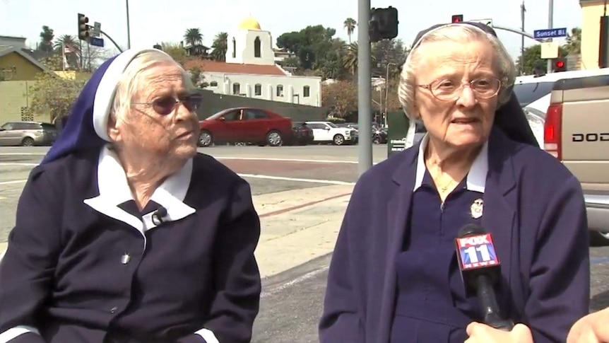 Two nuns speak to a reporter.