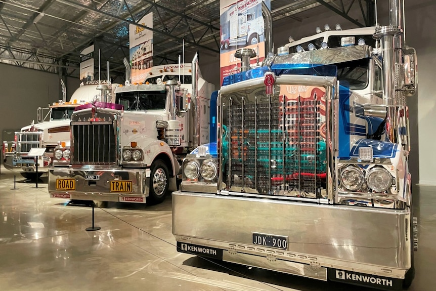 Three trucks lined up in a display