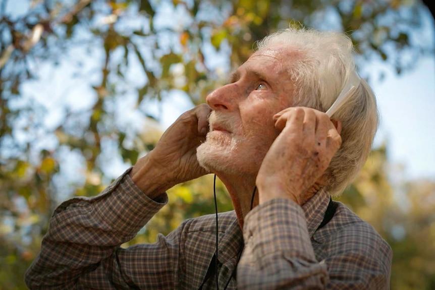 Field recordist John Hutchinson listens to birdsong