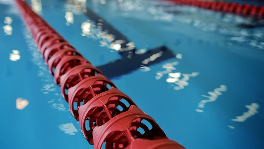 Big red lane ropes in a swimming pool.