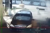CCTV images show the moment of an explosion next to a car at a security post