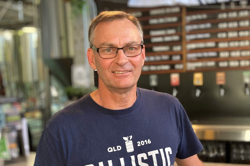 David Kitchen stands inside a micro brewery