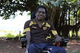 a man in a wheelchair outside