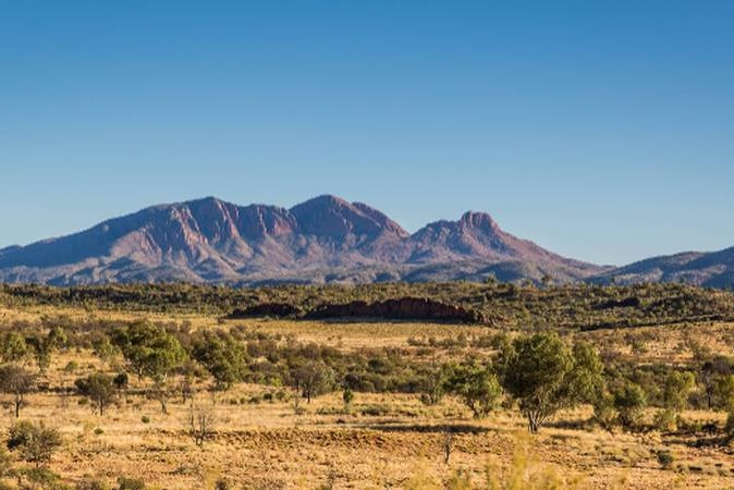 A view of the arid landscape with Mount Sonder on the horizon.