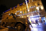 A Belgian soldier patrols near an armoured vehicle in central Brussels