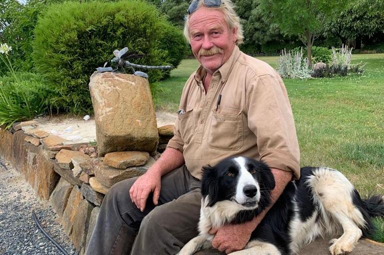 Latrobe farmer Andrew Craigie sits with his dog Sue