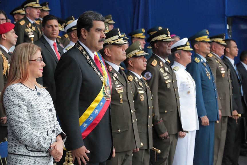 Venezuela's President Nicolas Maduro abruptly cut short his speech at a military event.