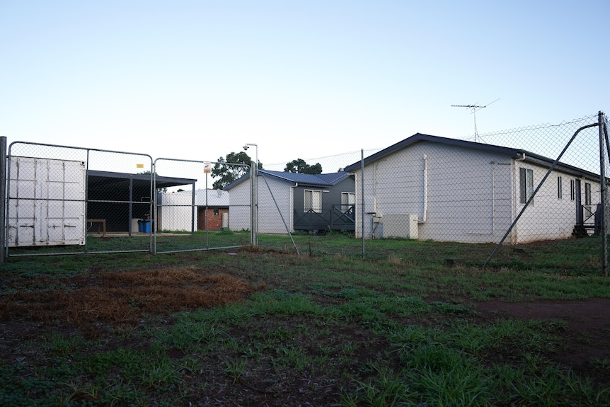 Transportable buildings behind a fence.
