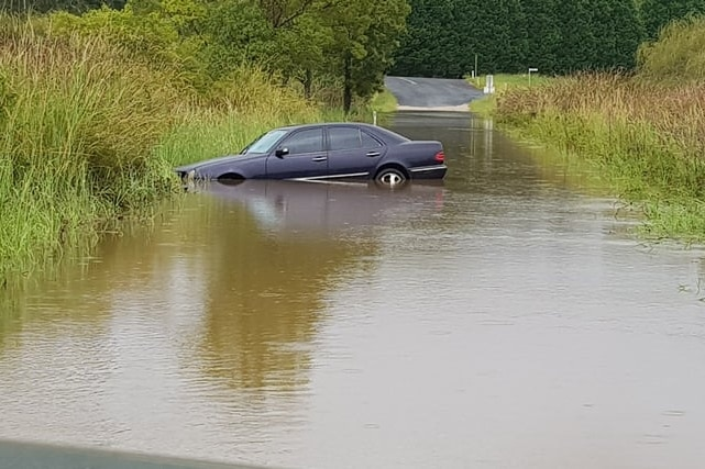 A car stuck in flooded waters