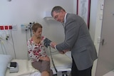 Professor Philip O'Connell examines Ruth Cummock at Westmead Hospital