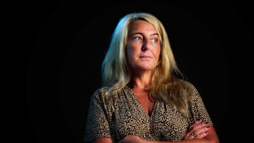 Nicola Gobbo, known as Lawyer X, wearing a leopard print dress stares into the distance.