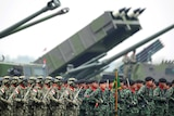 Indonesian military troops stand in formation.
