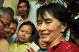 Burma opposition leader Aung San Suu Kyi visits a polling station