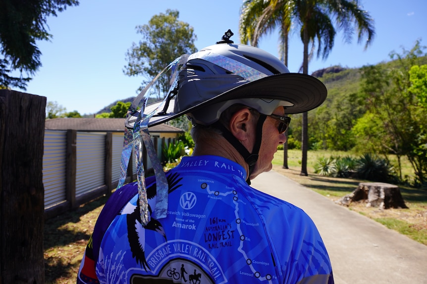 Silver tape attached to the back of a cyclist's helment