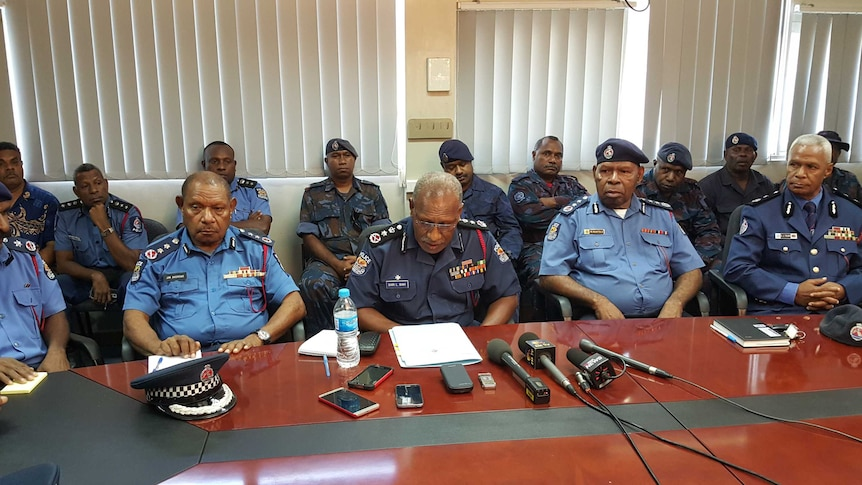 Police Commissioner Gari Baki (centre) surrounded by senior police officers.