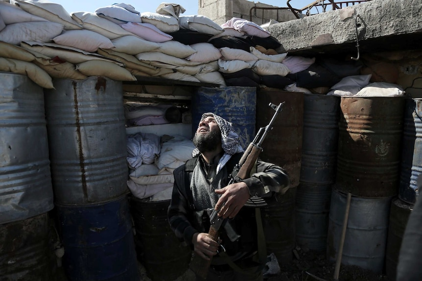 A Syrian rebel fighter from the Failaq al-Rahman brigade on the outskirts of Damascus.