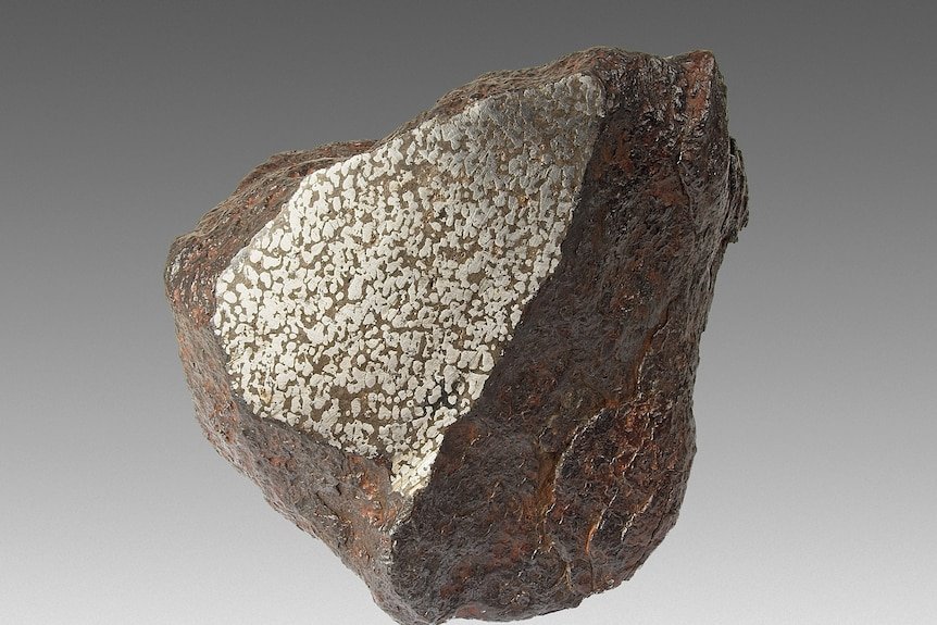 The meteorite shone bright, smooth and clean.