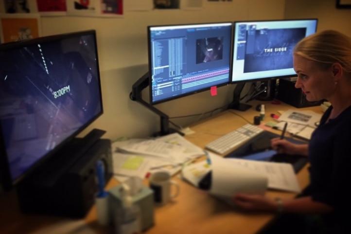 ABC graphic artist Peta Bormann working on The Siege programs.