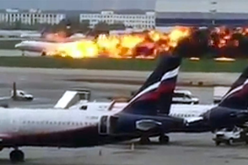 A plane lands in flame during an emergency landing.