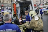 An injured woman is put into an ambulance after a subway blast in Russia