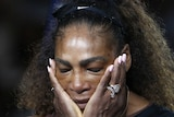 Serena Williams reacts during the trophy ceremony after the US Open women's final.