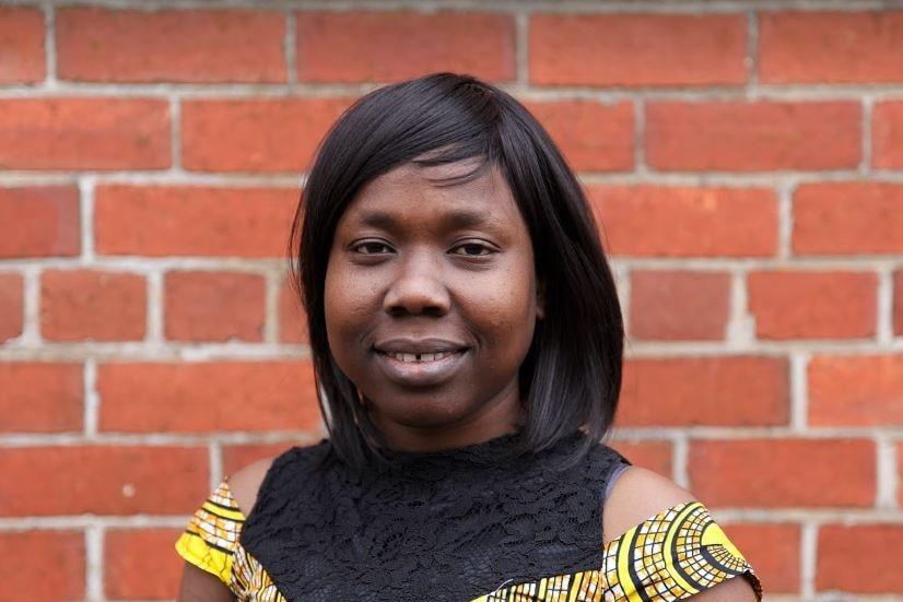Nene Manasseh from South Sudan in yellow dress.