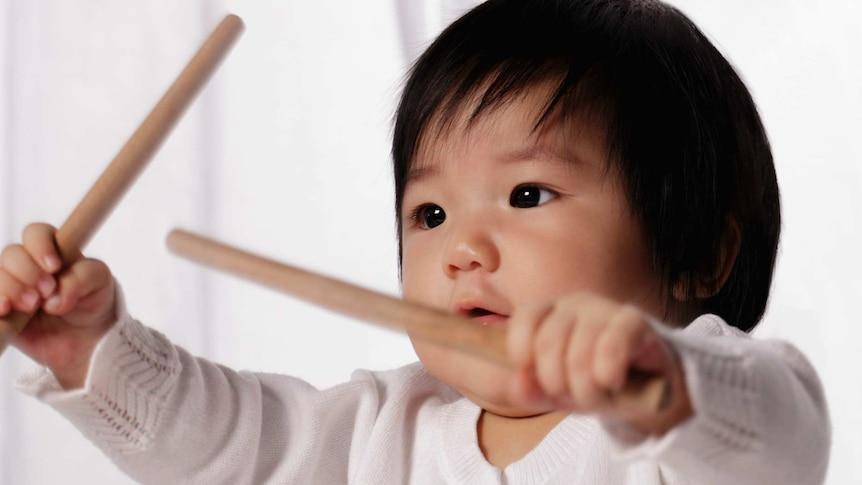 Baby girl playing drum