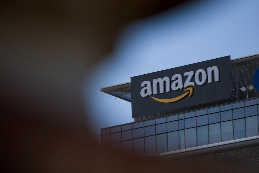 An Amazon owned building with a large logo on the side