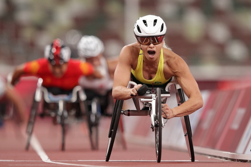 An Australian female wheelchair athlete crosses the line in first place at the Tokyo Paralympic Games.