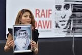 Ensaf Haidar holds a picture of her husband Raif Badawi.