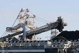 Coal is loaded onto ships.