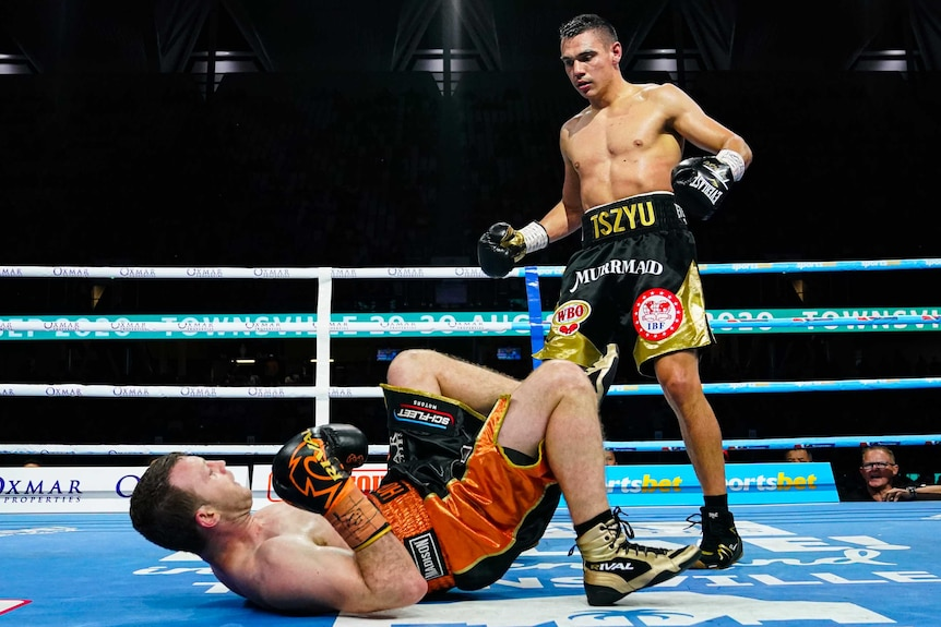 Tim Tszyu (right) looks on as Jeff Horn goes to the ground.