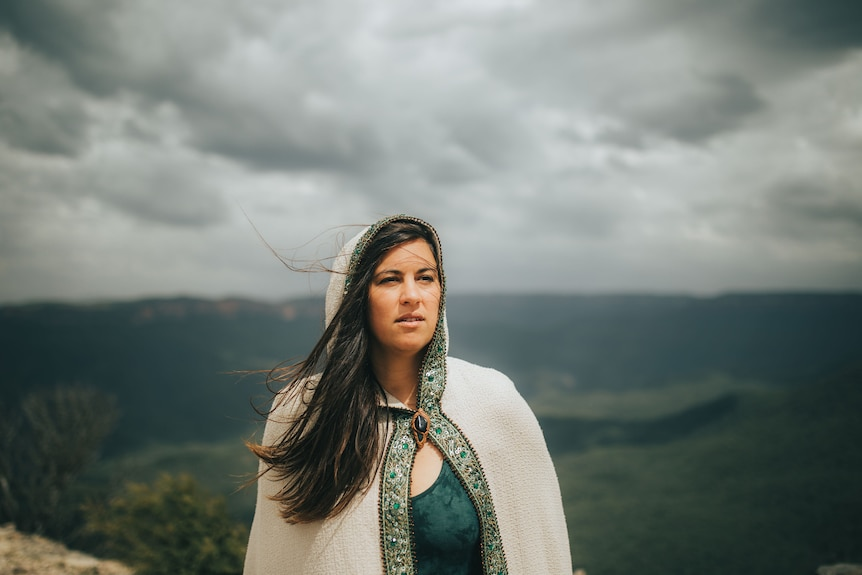 Julie Brett stands on a cliff in the Blue Mountains.