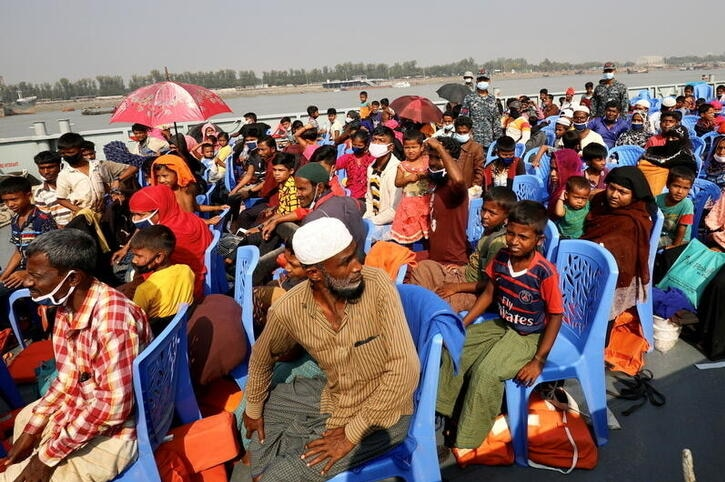 Rohingyas are seen onboard a ship as they move to Bhasan Char island in Chattogram, Bangladesh.