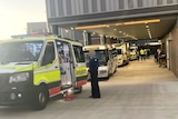 Ambulances lined up outside Roma Hospital emergency department