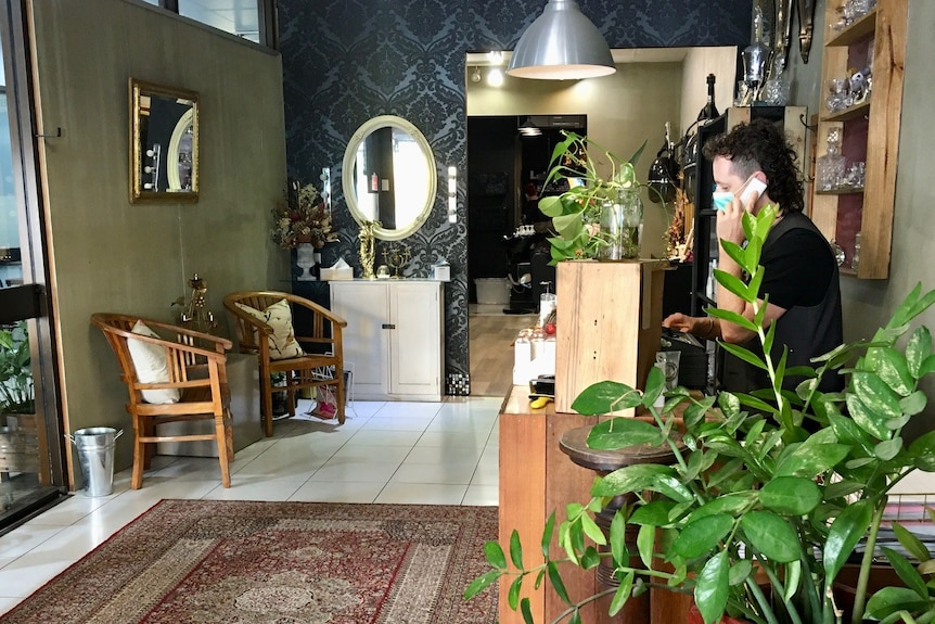 Man on the phone in his hair salon
