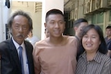 """Jatupat""""Pai Dao Din"""" Boonpattararaksa poses for a photo with his mother and father at a courthouse northeast of Bangkok."""