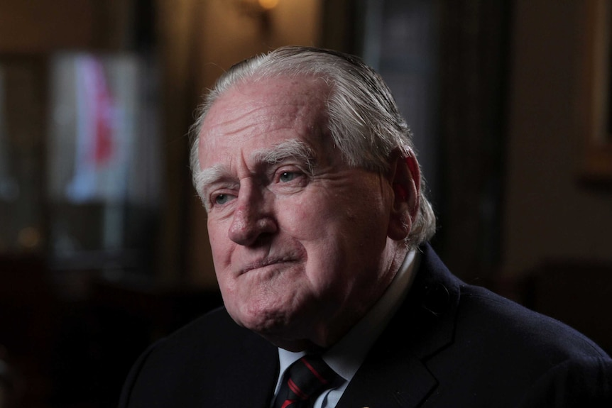 Head shot the Rev. Fred Nile looking off to the left of camera