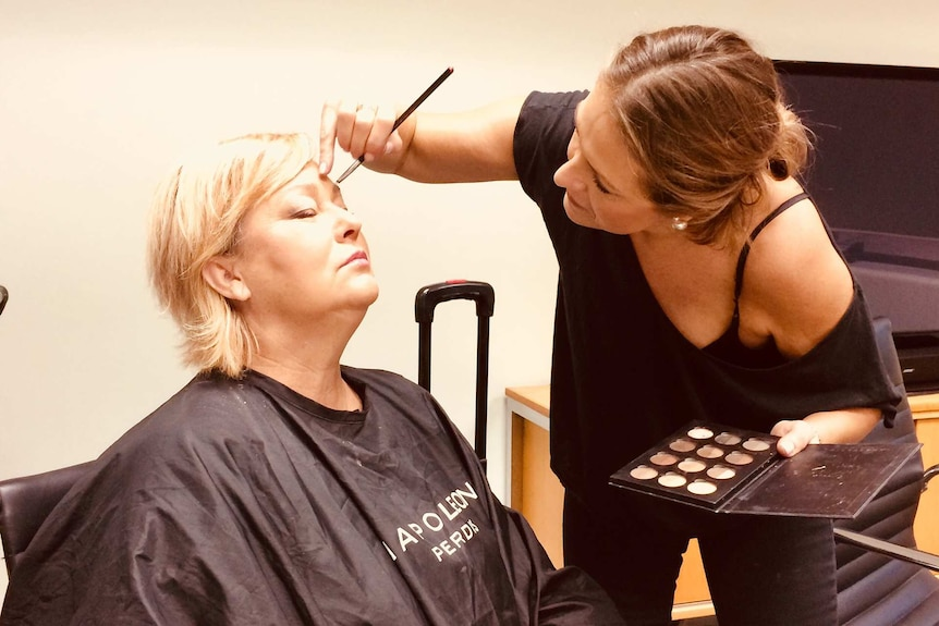 Lisa Rathgen at work as a makeup artist for a story on choosing a career that matches your personality