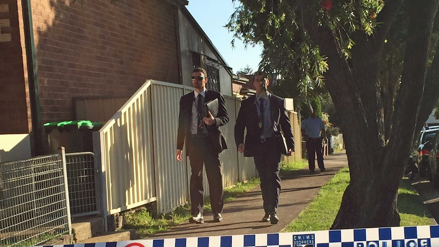 Police in Campsie where two bodies have been found