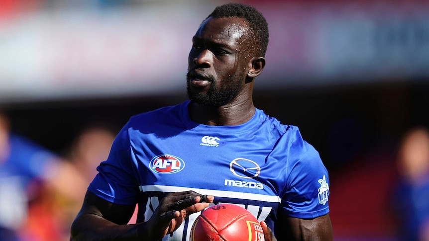 Majak Daw of the Kangaroos is seen following the round-nine AFL match against the Crows on the Gold Coast in 2020.
