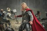 Man dressed as superhero holding a hammer