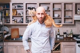 A portrait of man with his cat shot by Brooklyn-based photographer David Williams.