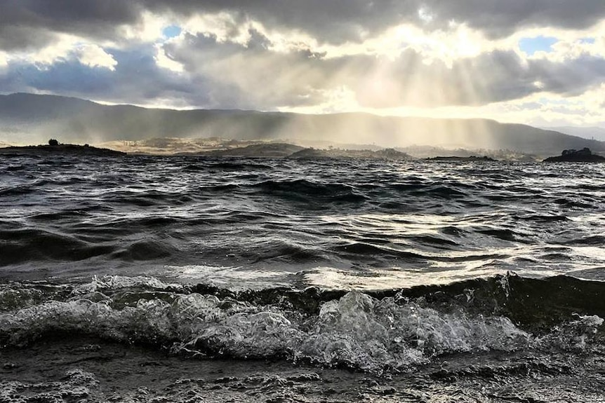 large waves on a normally calm body of water