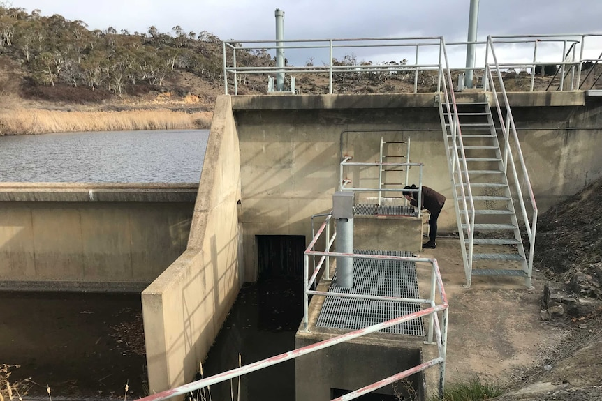 A woman looking at the equipment at at Snowy Mountains weir.