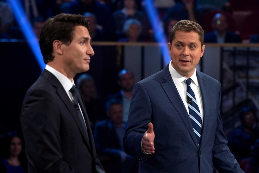 Canadian Opposition Leader Andrew Scheer talking next to Prime Minister Justin Trudeau