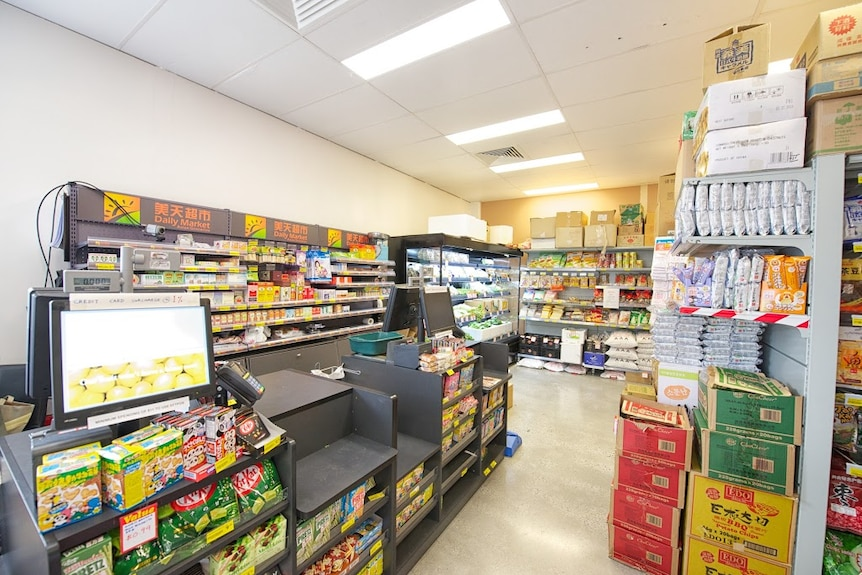 The inside of a small grocer, with two tills.