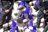 Drone footage shows hundreds of blindfolded and shackled prisoners being transferred in Xinjiang.