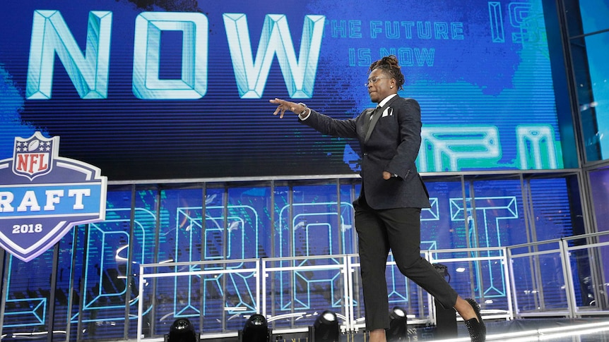 Central Florida's Shaquem Griffin walks out onto the stage at the start of the 2018 NFL Draft.