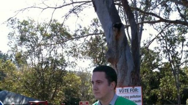 An LNP worker hands out voting information in Ryan.
